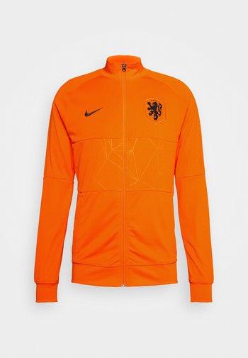 NIEDERLANDE KNVB - National team wear - safety orange/black