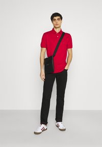 Tommy Hilfiger - 1985 REGULAR - Polo shirt - primary red - 1