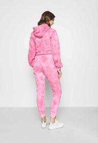Ellesse - LORIOR - Tracksuit bottoms - pink - 2