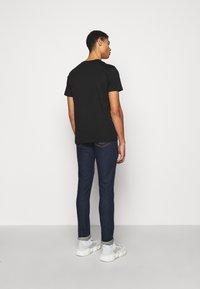 MOSCHINO - Print T-shirt - fantasy black - 2