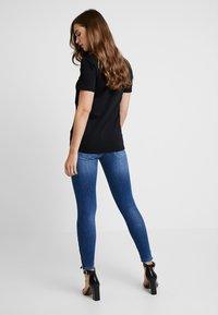 Diesel - SLANDY ZIP - Jeans Skinny Fit - indigo - 2