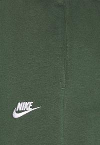 Nike Sportswear - CLUB PANT - Tracksuit bottoms - galactic jade/white - 2
