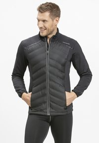 Endurance - MIT WARMER WINTERSTEPPUNG - Outdoor jacket - black - 0