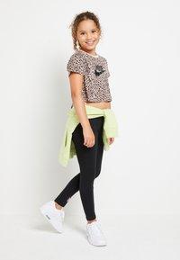 Nike Sportswear - TEE CROP  - Print T-shirt - fossil stone/black - 1