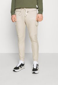 The Couture Club - LOOPBACK JOGGER - Tracksuit bottoms - stone - 0