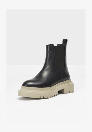 Platform ankle boots - black-sand bsd