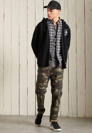 GRAPHIC - Zip-up hoodie - black