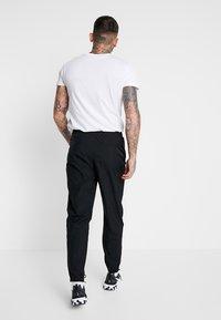 Nike Sportswear - PANT - Pantalon de survêtement - black/white - 2