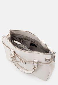 comma - TURN AROUND HANDBAG - Handbag - offwhite - 2