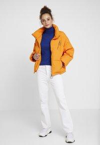 Benetton - OVERSIZED SPORTY SHORT DOWN JACKET - Down jacket - orange - 1