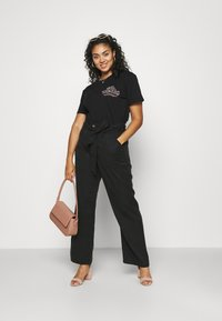 CAPSULE by Simply Be - SOFT WIDE LEG PANT - Trousers - washed black - 1