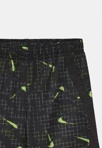 Nike Sportswear - GLOW IN THE DARK  - Shorts - black - 2