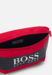BOSS - BUM BAG UNISEX - Across body bag - bright red - 2