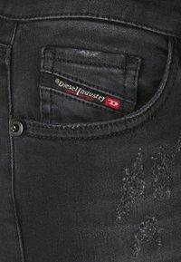 Diesel - SLANDY LOW - Jeans Skinny Fit - grey - 2