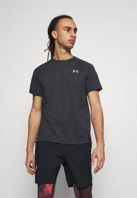 Under Armour - STREAKER - T-shirt basic - black - 0
