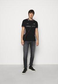 Hackett Aston Martin Racing - AMR  - Polotričko - black - 1