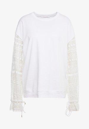 Sweatshirt - iconic milk