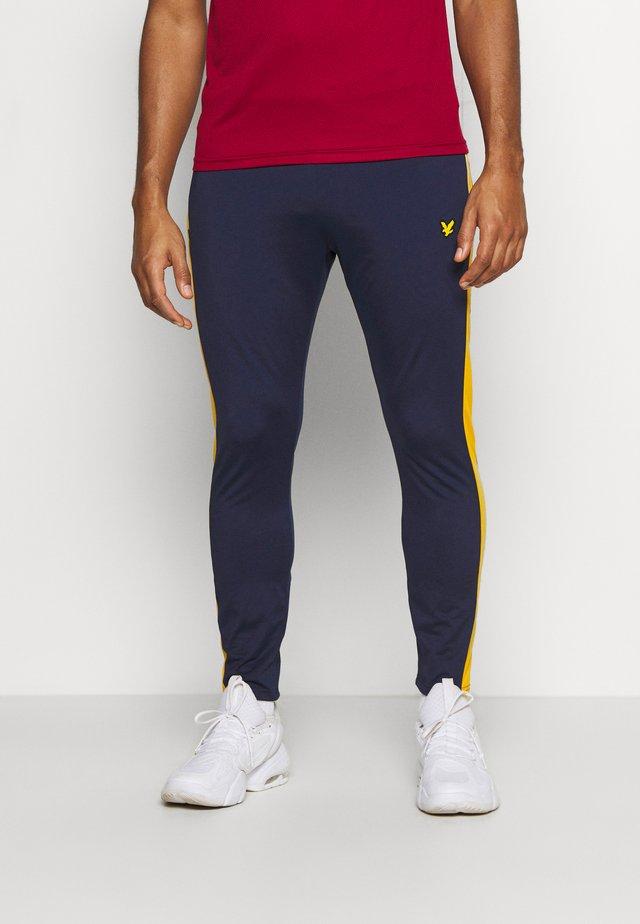TECH TRACK PANTS - Teplákové kalhoty - navy
