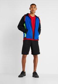 Nike Performance - Basic T-shirt - university red/black - 1