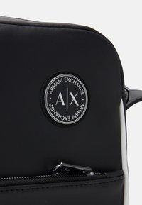 Armani Exchange - MANS CROSSBODY - Across body bag - black/white - 3