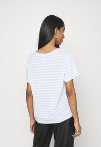Monki - SIMBA TEE 2 PACK - T-shirts print - light blue - 2