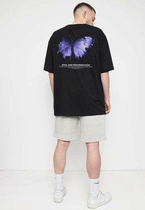 BUTTERFLY - T-shirt med print - black