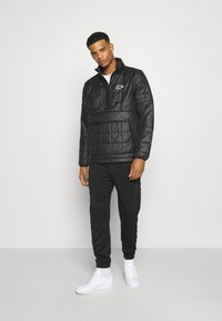 Nike Sportswear - ANORAK - Light jacket - black - 1