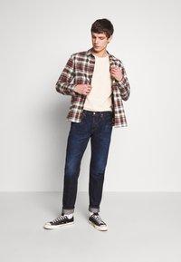 Edwin - REGULAR TAPERED - Straight leg jeans - dark blue denim - 1