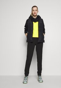 The North Face - WOMENS ACTIVE TRAIL SPACER - Sports shirt - black/lemon - 1