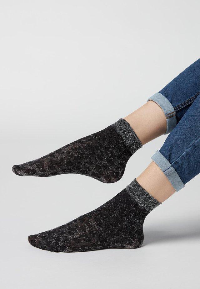 Socken - schwarz spotted black silver glitter