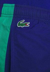 Lacoste Sport - TENNIS PANT - Spodnie treningowe - cosmic/greenfinch/white/black - 5