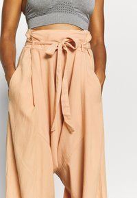 Free People - WADE AWAY HAREM - Trousers - med orange - 3