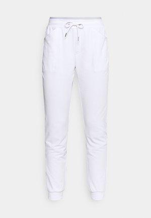 SOLE - Teplákové kalhoty - white
