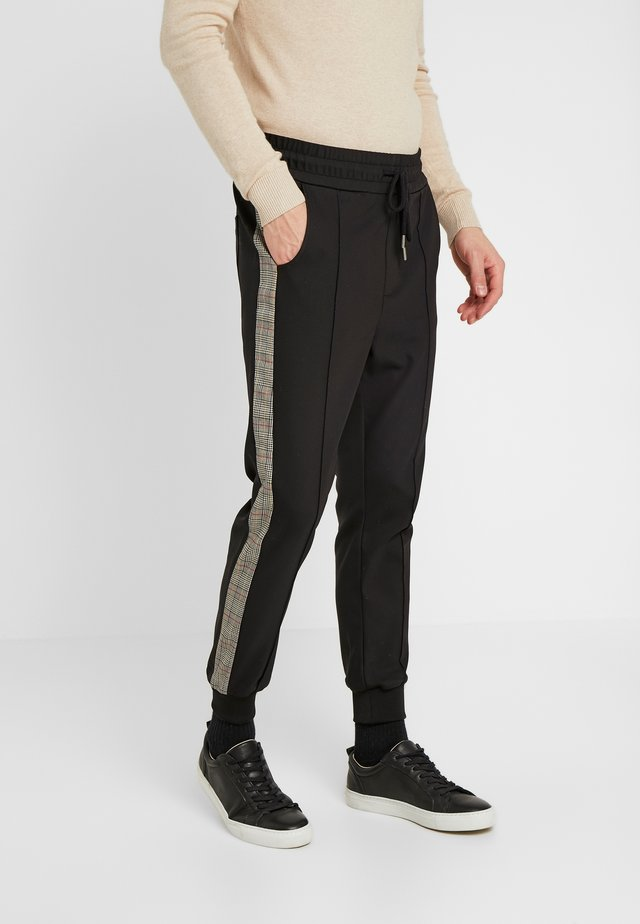 DOMINIK - Pantaloni - black