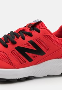 New Balance - 570 LACES UNISEX - Neutral running shoes - red - 5