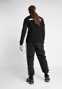 K1X - CHECKER PANTS - Tracksuit bottoms - black - 2