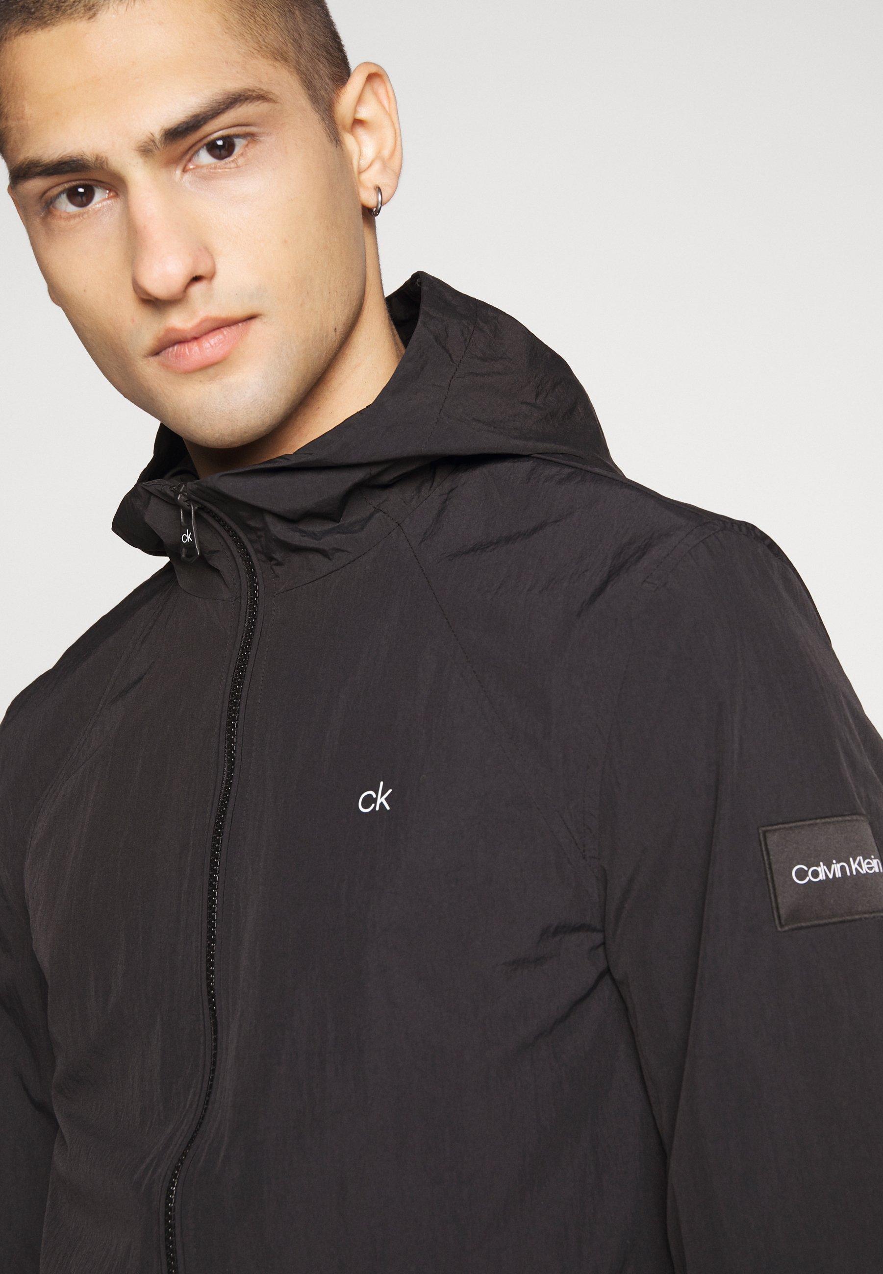Calvin Klein CRINKLE HOODED WINDCHEATER - Lett jakke - black