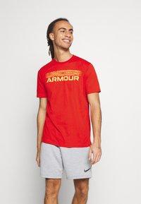 Under Armour - BLURRY LOGO WORDMARK  - T-shirts print - rich orange - 0