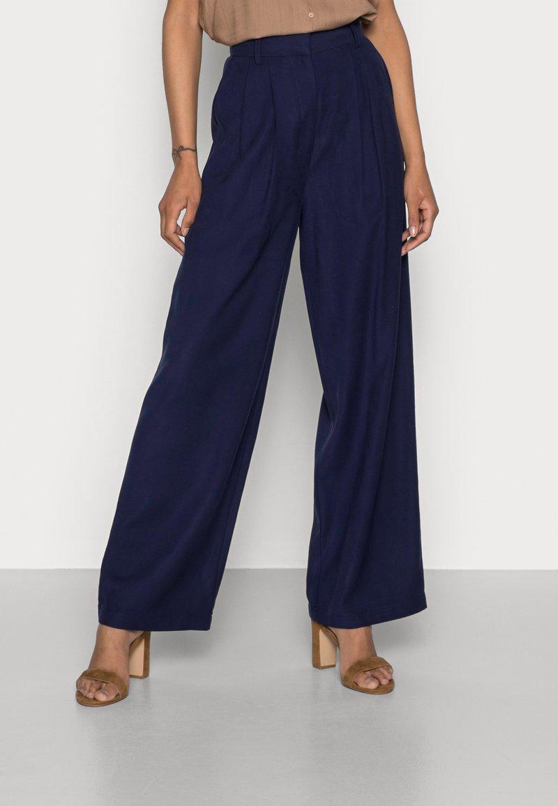 Anna Field - Basic wide leg pants - Trousers - dark blue