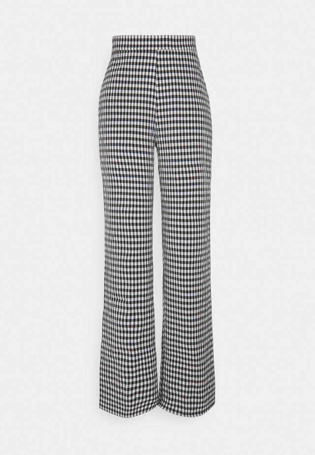 PCFIRUGGA PANTS - Trousers - bright white/black