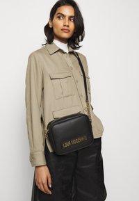 Love Moschino - BORSA SMOOTH - Across body bag - black - 0