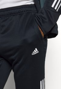 adidas Performance - FABRIC MIX AEROREADY SPORTS TRACKSUIT - Tracksuit - dark blue