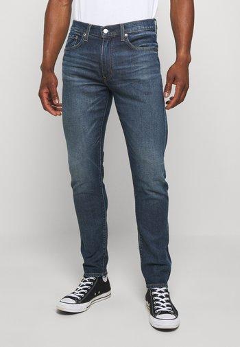 512™ SLIM TAPER - Slim fit jeans - blue denim