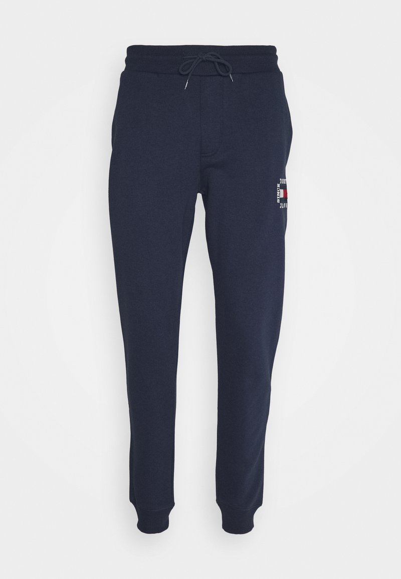 Tommy Jeans - SLIM BOX FLAG PANT - Tracksuit bottoms - blue