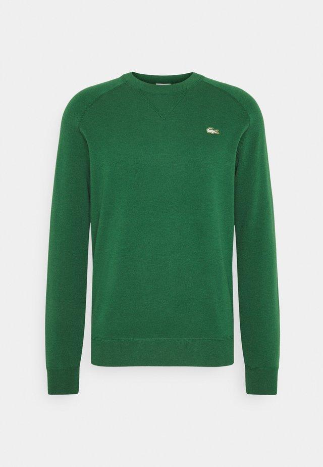 Strikkegenser - green