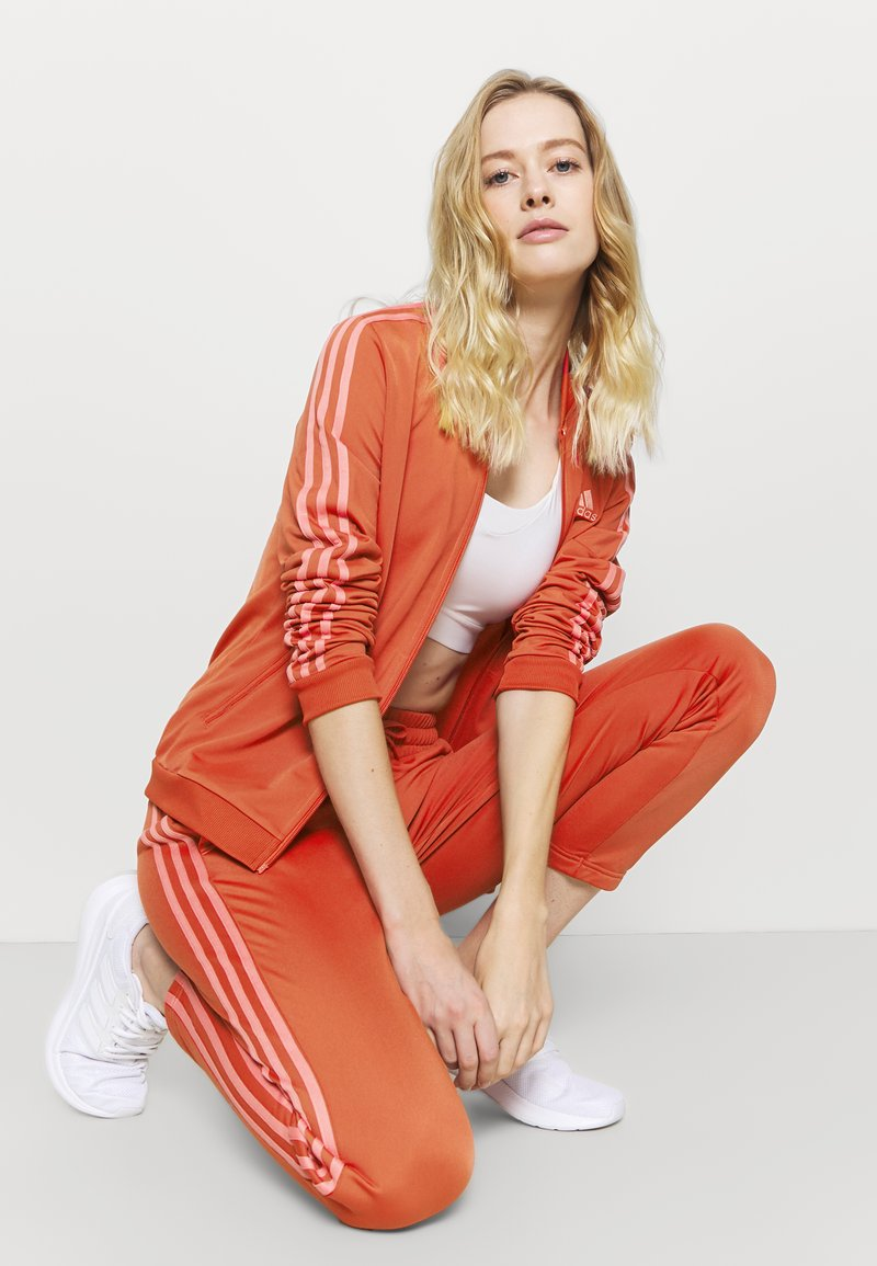 adidas Performance - Tracksuit - crered/hazros
