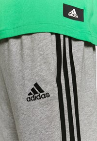 adidas Performance - Tracksuit bottoms - medium grey heather/black - 5