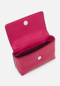 Calvin Klein - FLAP MINI BAG TOP HANDLE - Handbag - cerise - 2