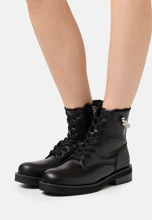 NOLLY - Lace-up ankle boots - black