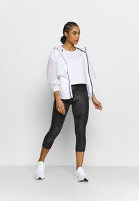 Puma - TRAIN TEE - T-Shirt basic - white - 1